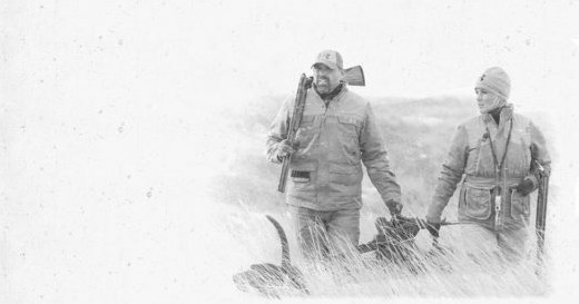 Man, Women, and Dog hunting black and white picture